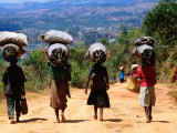 Local Women Carrying Charcoal in Bundles on their Heads Photographic Print by Olivier Cirendini