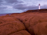 Lighthouse and Red Sandstone Cliffs Photographic Print by Guylain Doyle