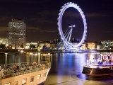 Blurred London Eye Reflected in the Thames at Night with Floating Restaurants in the Foreground Reproduction photographique par Orien Harvey