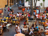 Busy Plaza De Santa Domingo During Peak Season in the Walled City Photographic Print by Paul Kennedy