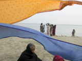 Woman Dries Her Sari Down by the Ganges Photographic Print by Gavin Quirke