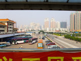 Bus Station at the Lowu, Hong Kong Border with Shenzhen, in the Special Economic Zone Photographic Print by Michael Coyne