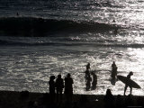 Beachgoers Silhouetted in Late Afternoon Sun, Cottesloe Beach Photographic Print by Orien Harvey