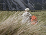 Man Resting on Walking Track in Hooker Valley Photographic Print by Holger Leue