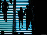 Silhouetted People on Illuminated Staircase in Causeway Bay Photographic Print by Richard I'Anson
