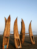 Caballitos De Totora Stacked Vertically in Order to Dry Between Fishing Trips Photographic Print by Paul Kennedy