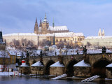 Snow Covered Prague Castle, Charles Bridge and Suburb of Mala Strana Photographic Print by Richard Nebesky