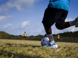 Torres Strait Islander Boy Taking a Goal Kick During a Soccer Game Photographic Print by Tim Barker