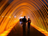 People Walking Through One of the 13 Illuminated Fountains at El Parque De La Reserva Photographic Print by Paul Kennedy