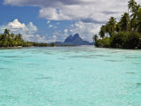 Bora Bora at End of Channel Between Two Motus in Taha'a Lagoon Photographic Print by Emily Riddell