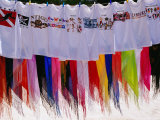 T-Shirts and Sarongs for Sale at Stall on Beach at Long Bay Photographic Print by Richard I'Anson