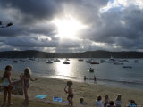 People on Barrenjoey Beach with Yachts in Background, Pittwater Photographic Print by Orien Harvey