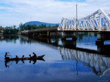 Bridge over Kampot River and Fishing Canoe Photographic Print by Antony Giblin