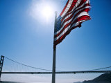 American Flag Flying with the Golden Gate Bridge in Background Photographic Print by Ray Laskowitz