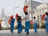 Women Practising Tai Chi with Fans on the Bund Photographic Print by John Banagan