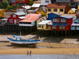 Brightly Painted Stilt Houses on Waterfront Photographic Print by Bethune Carmichael