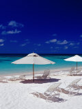 Beach Chairs and Umbrellas on Long Bay Beach Photographic Print by Richard I'Anson