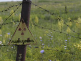 Sign on Barbed-Wire Fence of Radioactive Waste Dump in Use Within City Limits Photographic Print by Christopher Herwig
