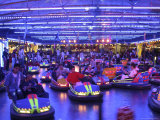 Teenagers Ride Bumper Cars under Neon Blue Lights Photographic Print by Dominic Bonuccelli