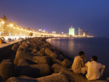 People Relax at the End of Day Along Marine Drive Photographic Print by Orien Harvey