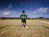 Torres Strait Islander Boy Standing in Goal During a Soccer Game Photographic Print by Tim Barker