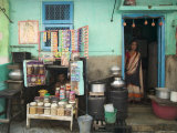 Husband and Wife Outside their House That Acts as a Shop Photographic Print by Gavin Quirke