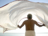 Man Dries His Lungi in the Winds by the Ganges Photographic Print by Gavin Quirke