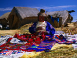 Traditionally Dressed Woman Knitting on Isla Flotantes Photographic Print by Ryan Fox