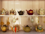 Display of Assorted Tea Pots, Spoons and Strainers at Tea Pot Restaurant Photographic Print by Felix Hug