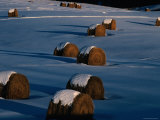 Hay Bales Lie in the Snow Covered Fields of Vermont Photographic Print by Kim Grant