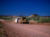 Grader Heads Out Near Nullagine in Western Australia Photographic Print by Peter Ptschelinzew