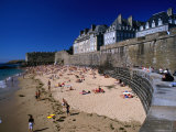 People Sunbathing on Plage De Bon Secours Beach Outside the Old City Walls Photographic Print by Rocco Fasano