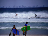 Surfers with Surfers Paradise in Distance Photographic Print by John Borthwick