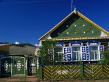 Traditional Painted Cottage in the Picturesque Village of Baikalskoe Photographic Print by Simon Richmond