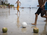 Boys Playing Beach Football with Coconut Goal Posts Photographic Print by Holger Leue