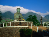 Statue of Buddha Sitting Amongst Mountains and Clouds at the Jodo Mission Photographic Print by Ann Cecil