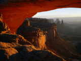 Breathtaking View Down the Canyon from a Warmly-Lit Mesa Arch Photographic Print by Rob Blakers