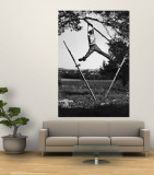 Kenneth Merriman Swinging on Tree Limb After Kicking Away Stilts Premium Wall Mural by Robert W. Kelley