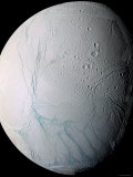 Saturn's Moon Enceladus Photographic Print by  Stocktrek Images