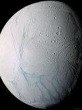 Saturn's Moon Enceladus Photographic Print by  Stocktrek Images