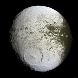 Saturn's Moon Iapetus Photographic Print by  Stocktrek Images
