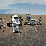 View of Suited Test Subject and 1-G Lunar Rover Vehicle Photographic Print by  Stocktrek Images