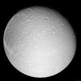 Saturn's Moon Dione Photographic Print by  Stocktrek Images