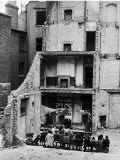 Children in Aldgate Using the Ruins of a Bombed House as a Stage for a Vaudeville Show Premium Photographic Print by Hans Wild
