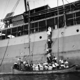 People Climbing Down a Ladder, Trying to Board an Already Overfull Lifeboat, as SS Zam Zam Sinks Photographic Print by David Scherman