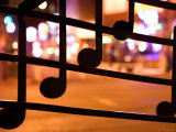 Close Up of Artistic Wrought Iron Musical Notes at Night Photographic Print