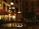 People Sitting and Eating at Busy Cafe in Paris, France at Night Photographic Print