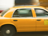 Blurred Motion of a Speeding Taxi Cab on a Busy Street Photographic Print