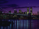 Skyline of New York City with Illuminated Lights Off Buildings and High-Rises at Night Photographic Print