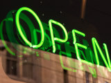 Green Neon Light in Reflective Store Window Photographic Print